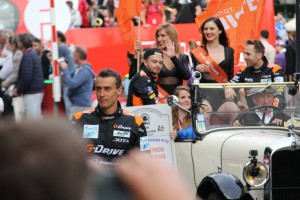 Roman Rusinov, Driver Of #26 G-Drive Racing with Rene Rast and Will Stevens (Background) - Photo Roger Jenkins